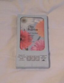 PACK OF THREE 10 x 15CM CLIP FRAMES WITH METAL CLIPS. NEW IN PACKET.