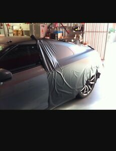 Gloss black roof wrap from $120 - Chrome delete from $50