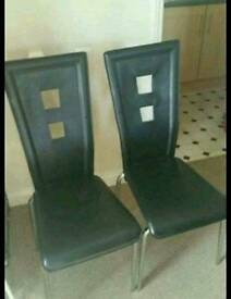 Glass table and 2 black leather chairs for sale!