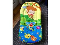 Musical Melodies Soothing Baby Bouncer/Rocker with Vibration and 4 hanging toys