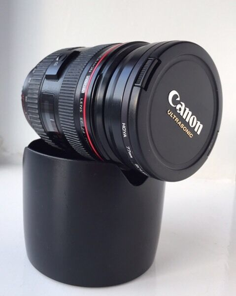 Canon 24-70mm f/2.8L USM Lens. Lens hood.Original box. Includes Hoya 77mm Skylight Filter
