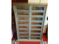 Wooden cd/dvd storage unit with sliding glass doors bought from Argos