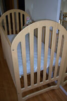 Fisher-Price crib with a mattress