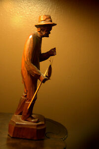 FOLK ART WOODEN FIGURE....OLD FISHERMAN WITH FISH