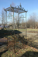 Antique wrought iron fence and arbor