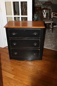 Black cabinet also a cream desk and chair