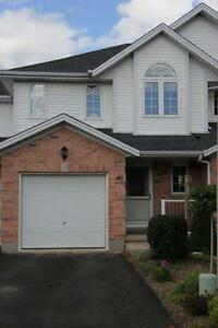 BEAUTIFUL TOWNHOME-BACKS ONTO RIVER, UPPER DECK, WALKOUT, PATIO