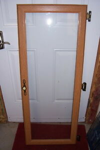 Glass and wood cabinet door with hardware