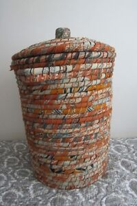 Beige and tangerine laundry basket