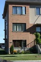 RENOVATED MODERN, BIG CONDO IN THE HEART OF CHOMEDEY