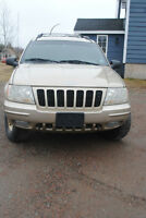GRAND CHEROKEE LTD 4 X4 plus one NEW TIRE / RIM