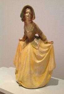 Sculpture antique figurine jaune 1950