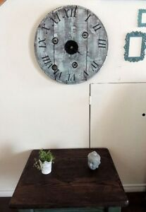Wooden spool clock with roman numerals
