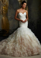 All wedding gowns being sold at cost. Brand new designer gowns.