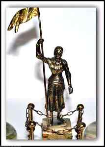 ANTIQUE PATINATED AND ONYX JOAN OF ARC SCULPTURE FROM THE 1800s