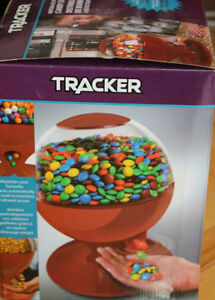 NEW IN BOX TRACKER MOTION ACTIVATED CANDY, PEANUT DISPENSER