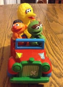 Vintage 1980 Sesame Street Illco. Wind -up car big bird Oscar...