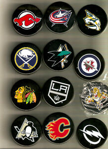 Coors hockey puck openers and sweater openers to sell or trade St. John's Newfoundland image 1