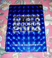 2004 HARDCOVER GUINNESS BOOK OF WORLD RECORDS PHOTOS FACTS