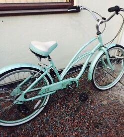Vintage style mint green ladies bike