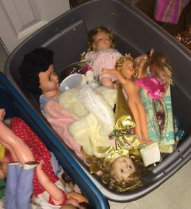 2 bins full of vintage dolls.