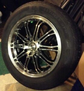 Set of 4 wheels and tires.