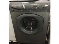 Silver Hotpoint washer dryer washing machine