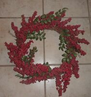 Red berry wreath with some greens