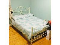 Cream iron double bed & mattress