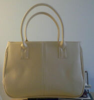 Light Yellow Purse and a Black shoulder bag