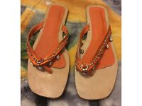 Size 3 sandals / shoes by Unze in orange