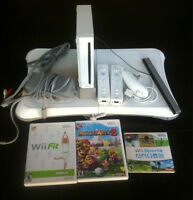 WII console + Wii Fit Board + 2 controllers + 3 games