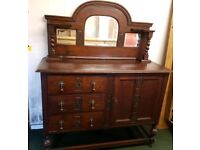 Antique sideboard with bevelled mirro