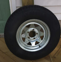 "14"" galvanized rim and 205/75 tire"