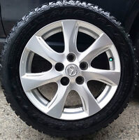 4 mags mazda 16'' . Bolt Pattern: 5x114.3 mm , Les mags sont bon