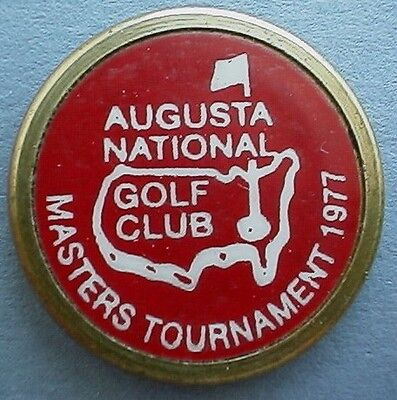 Another fake on the left (with incorrect spelling of Masters). Original ball marker on the right.