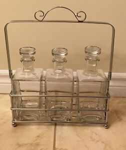 Glass decanter set with metal stand