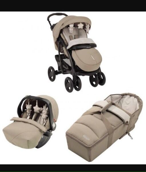 Graco Quattro Tour travel deluxe system and car seat base
