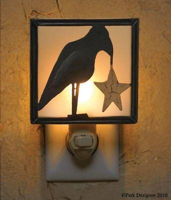 NIGHT LIGHT WITH BLACK OLDE CROW HOLDING GOLD STAR 5 WATT BULB 5 3/4