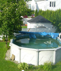 Piscine ovale 12x24 spas piscines longueuil rive for Balayeuse piscine automatique