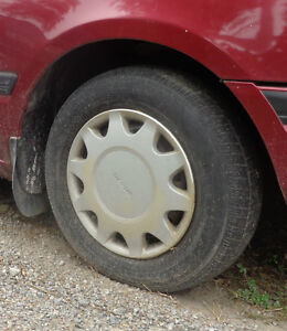 1992 Mazda Protege rims and tires