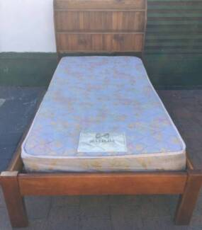 Good condition wooden frame single bed with Sealy Brand mattress