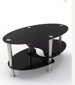 Black glass oval coffee table/tv stand with chrome legs