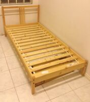 IKEA single wooden bedframe with slats. $40 firm.