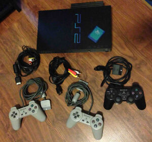 SONY PLAYSTATION 2 (PS2) with controllers & 36 games - $150.00