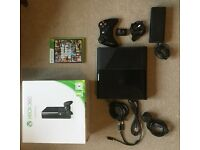 Xbox 360E, grand theft auto 5 (both discs) and rechargeable battery pack+charger