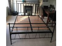 Black iron double bed frame