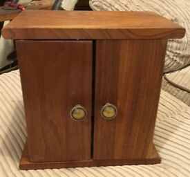 Miniature cupboard with drawers