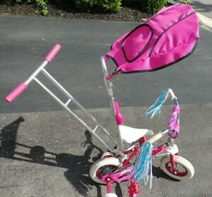 AWESOME girls' bike with CANOPY and STEERING HANDLE.  Almost new