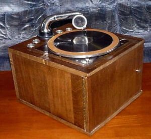 Antique gramophone record player. Walnut finish.